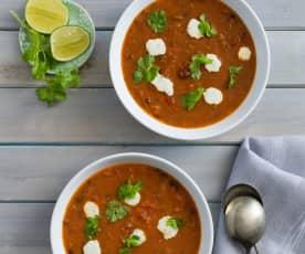 Black bean tomato soup with coriander lime cream