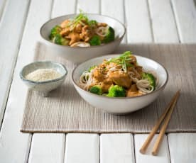 Orange sesame chicken with broccoli and noodles