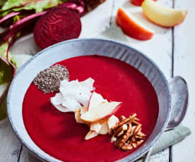 Pink smoothie bowl with coconut and pecans