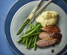 Duck breasts with orange ginger sauce, mashed potatoes and green beans