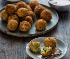 Pumpkin and blue cheese arancini with smoky yoghurt dressing