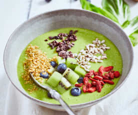 Green smoothie bowl with seeds and berries