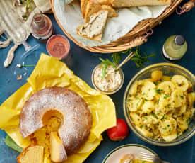 Pique-nique : salade de pommes de terre, dip roquette-tomates, pain d'épeautre, kouglof au citron