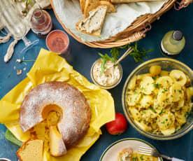 Picnic: insalata di patate, dip alla rucola e pomodori, pane di farro, ciambella al limone