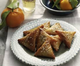 Almond briouats with honey and sesame seeds