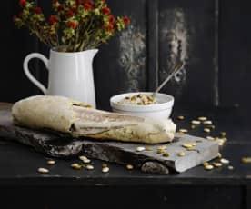 Robalo no pão com arroz de champanhe e frutos secos