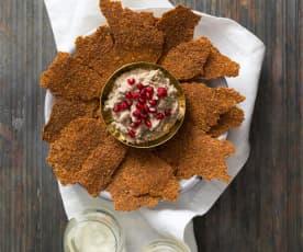 Linseed crackers with mutabbal beitinjan (eggplant dip)