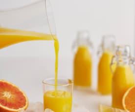 Sumo de manga, laranja e gengibre