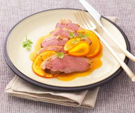 Magret de canard en papillote, sauce à l'orange