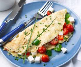 Tortilla de pimientos y cherrys con queso fresco