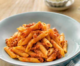 Pasta in tomato sauce with ham and chorizo