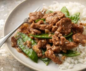 Cerdo thai con arroz y tirabeques