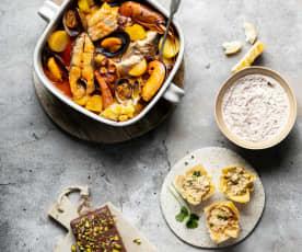 Menú: Cremoso de cecina. Tartaletas de marisco. Zarzuela de pescados y mariscos. Turrón de chocolate y pistachos.