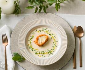 Merluza con costra de patata y crema de puerros ahumada
