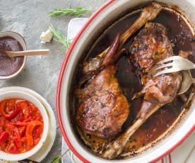 Pierna de lechal asada al vino tinto con pimientos al ajillo y salsa de cecina