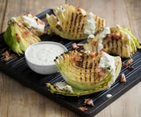 Grilled cabbage with blue cheese dressing and bacon