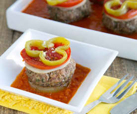 Layered patties and vegetables with bell pepper sauce