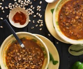 Judías carillas con calamares en salsa americana (Cocción lenta)