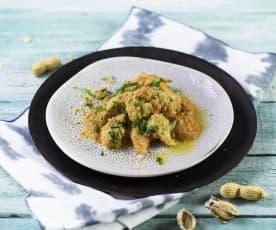 Hühnerbruststreifen in Erdnusssauce