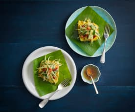 Steamed sea bass wrapped in banana leaves with green mango salad
