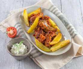 Ripperl in Paradeiser-Chili-Sauce