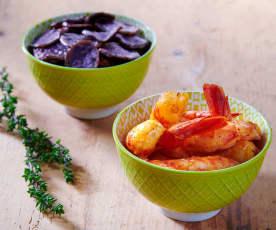 Gamberoni con chips di patate viola e timo