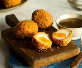 Uova scozzesi con salmone e salsa alla senape