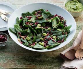 Spinach salad with crunchy quinoa and green goddess dressing