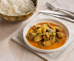 Curry de cerdo y arroz blanco al vapor - India