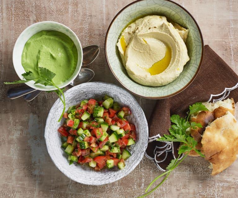 Hummus, grüne Tahina und israelischer Salat