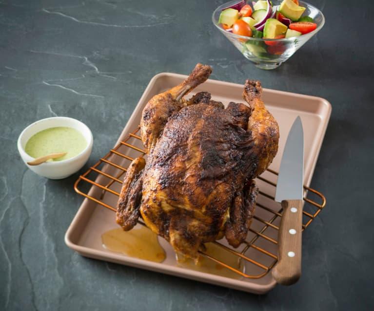 Peruvian roast chicken with green sauce and avocado salad