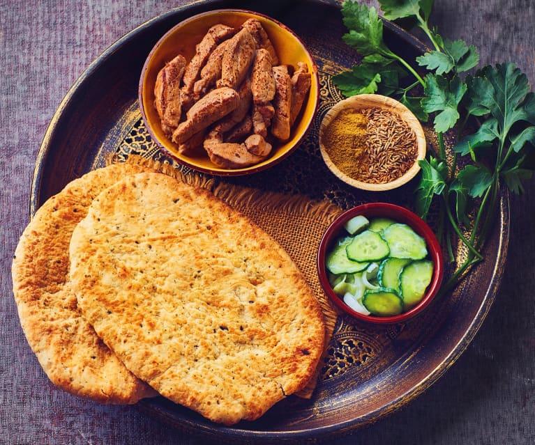 Filetto di maiale con salsa speziata al cocco e pane naan all'aglio