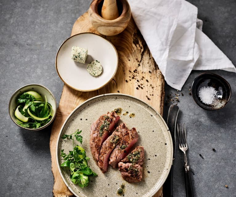 Rare beef steak with herb garlic butter