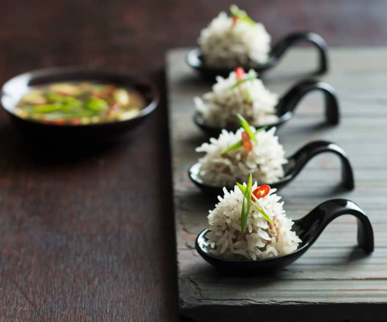 Steamed rice balls with spicy lime dipping sauce