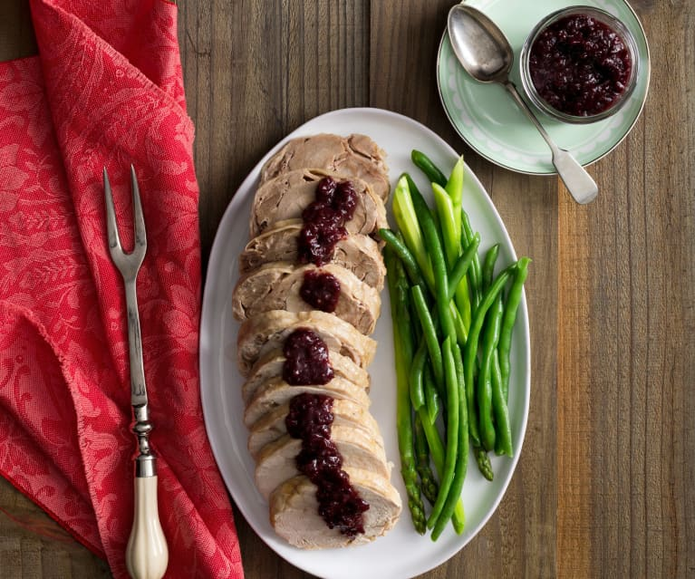 Turkey roll with cranberry and cherry sauce