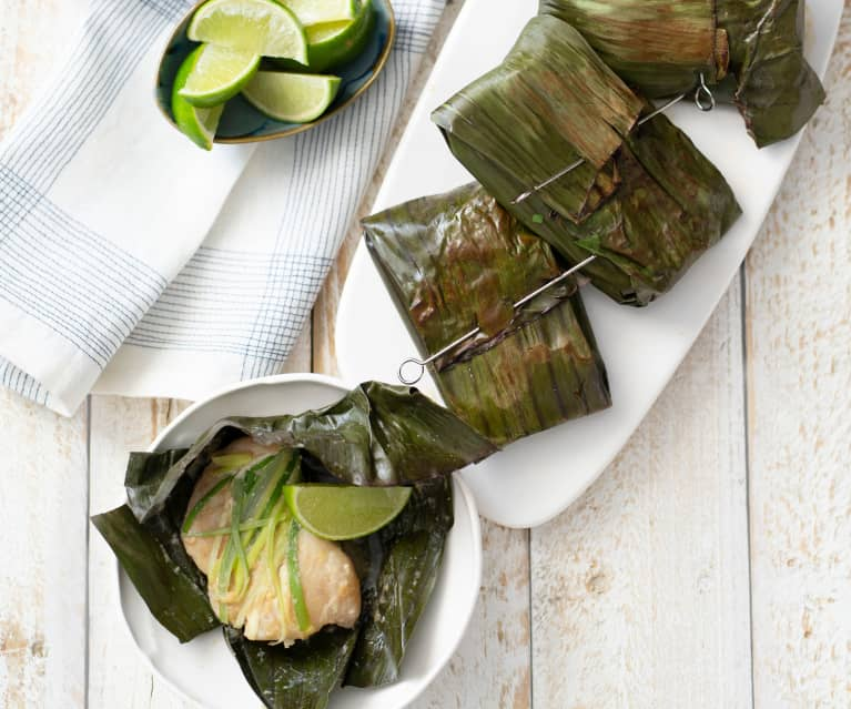 White fish wrapped in banana leaves