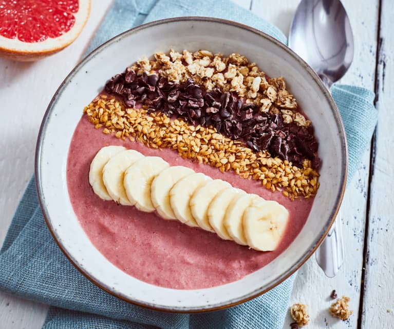 Cherry smoothie bowl with cacao nibs and muesli