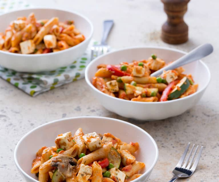 Tomato pasta with vegetables and feta