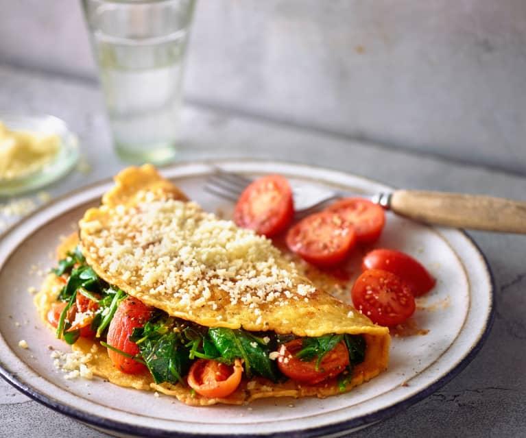 Tortilla francesa rellena de espinacas y queso con tomates cherry